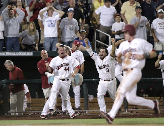 South Carolina's Adam Matthews scores the winning run as his teammates run to greet him at home plate (Adam Streur/WBR)
