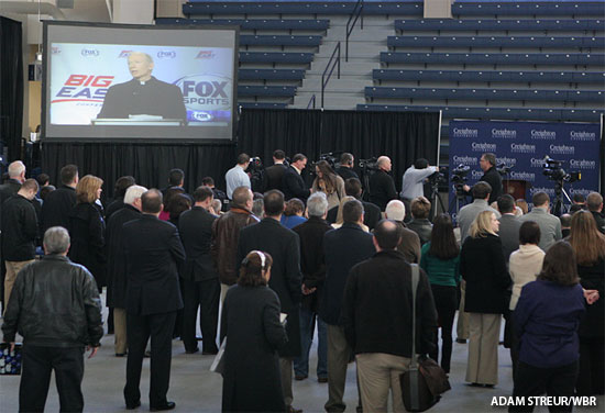 The crowd of media and fans inside DJ Sokol Arena watches the Fox Sports announcement. (Adam Streur/WBR)