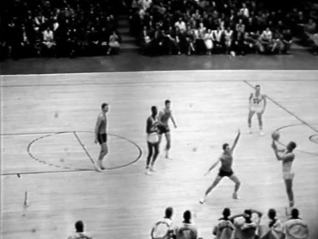 Chuck Officer launches a desperation buzzer-beater against Notre Dame in December of 1961. (Still frame from game film)
